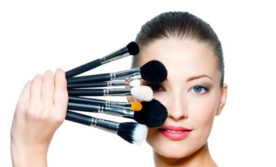 http://www.dreamstime.com/stock-images-portrait-beautiful-woman-make-up-brushes-image17009224