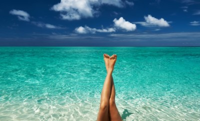 http://www.dreamstime.com/royalty-free-stock-image-woman-s-beautiful-legs-beach-image30220386