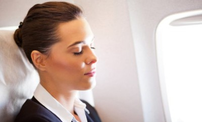 http://www.dreamstime.com/royalty-free-stock-images-businesswoman-resting-airplane-image23911809