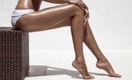 http://www.dreamstime.com/stock-image-beautiful-woman-tan-legs-against-white-wall-s-image39817221