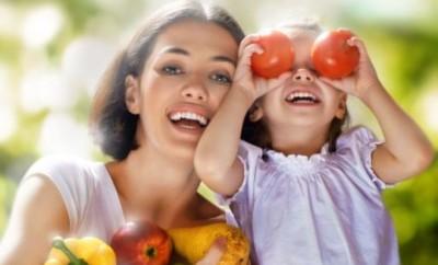 happy family keeps fresh vegetables