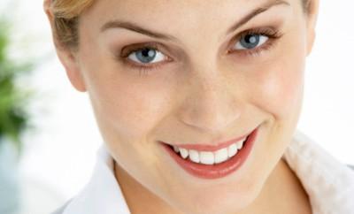 Studio Portrait Of Smiling Businesswoman